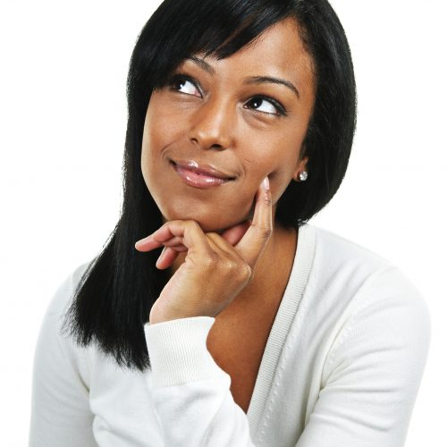 Thoughtful black woman looking up  isolated on white background